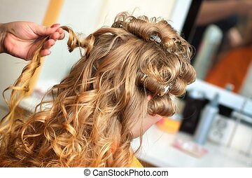 Bride at the hairdresser - The hairdresser does a hairstyle ...