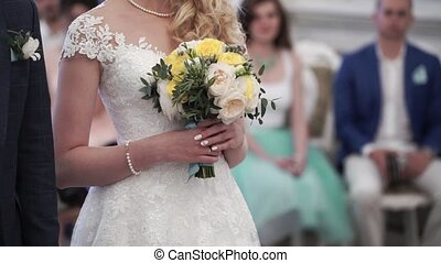 Bride at wedding ceremony indoors