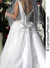 Bride - Back view of bride in wedding gown.