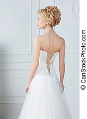 Bride. Back view. Sleeveless Wedding Dress.