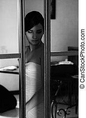 Bride behing mirror doors