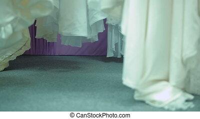 Bride Chooses Dress In Bridal shop