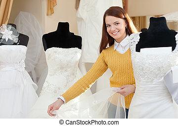 bride chooses wedding gown