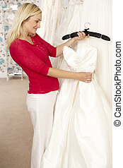Bride choosing wedding dress