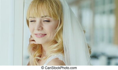 Bride close-up - dreams, smiles, wind blowing in her hair