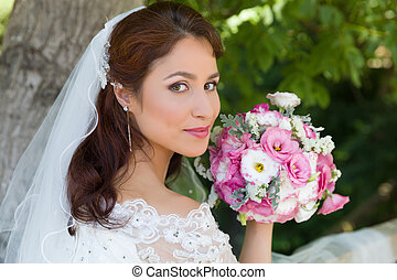 Bride closeup in garden