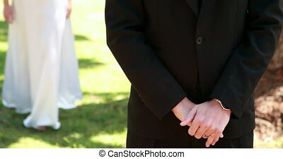 Bride covering her grooms eyes and smiling at camera on a...
