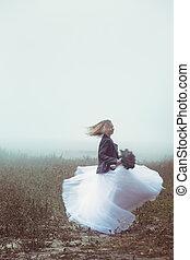 bride dancing in the field