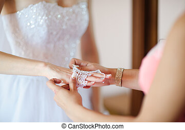bride dressing white gloves