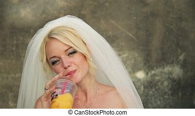 Bride drinking orange juice