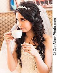 Bride drinking tea