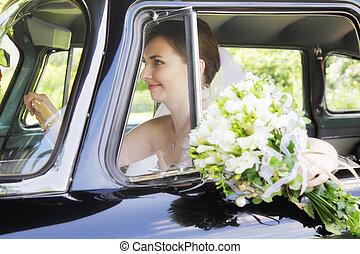 Bride driving car