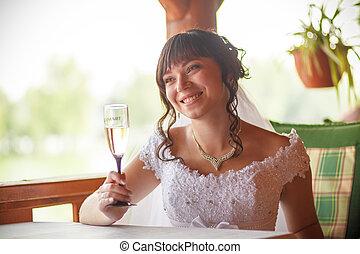Bride glasses of champagne Restaurant