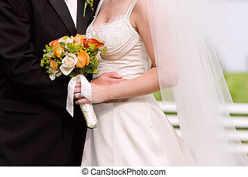 bride, groom and bouquet - bride holding her bouquet with...