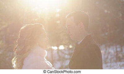 Bride groom on wedding photosession in forest winter outdoors.