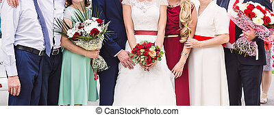 Bride, guests and bridesmaids at  wedding ceremony outdoors