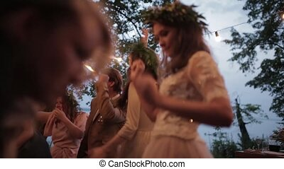 Bride guests dancing nature - Bride dancing cheerfully with...