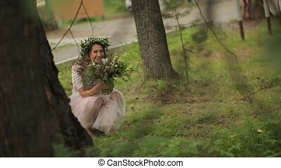 Bride hid behind tree forest