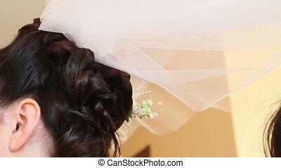 Bride hold veil - brunette bride hold her white wedding veil