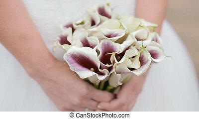 Bride hold wedding bouquet