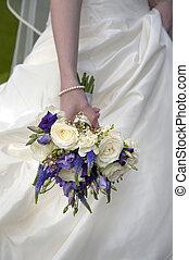 bride holding a wedding bouquet