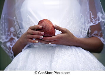 Bride holding apple