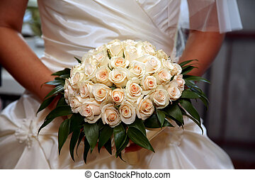 bride holding beautiful wedding bouquet of roses