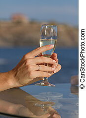 Bride holding bocal with champagne - Bride holds a bocal...
