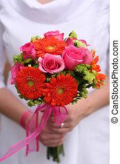 Bride holding bouquet 2 - Bride is holding bouquet of...