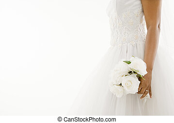 Bride holding bouquet. - African-American bride holding...