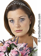 Bride Holding Bouquet And Crying