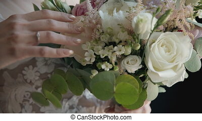 Bride holding bouquette on wedding ceremony.