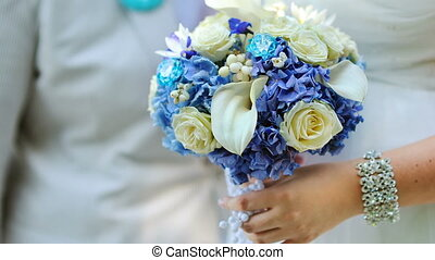 Bride holding in her hand a beautiful wedding bouquet of...