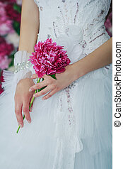 Bride holding the peony flower