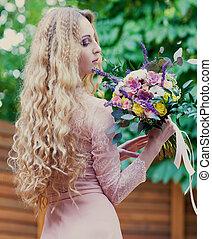 Bride holding the wedding bouquet