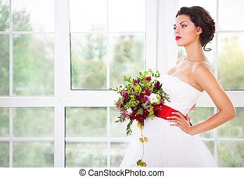 Bride holding unusual wedding bouquet