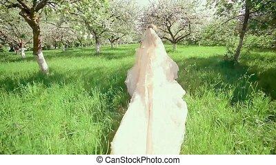 Bride in a Blooming Apple Garden Run