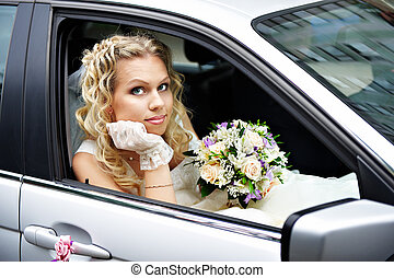 Bride in a wedding car