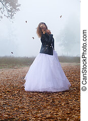 Bride in a wedding dress and a leather jacket