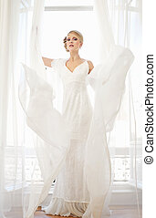 Bride in Long White Wedding Dress
