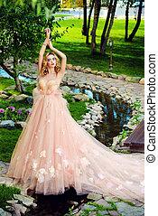bride in peach dress