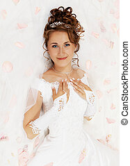bride in petals of roses - Beautiful young bride on the...