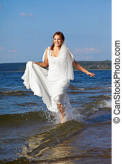 bride in sea waves