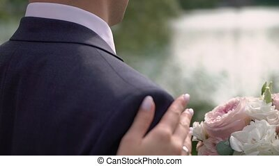 Bride in splendid wedding dress coming to handsome groom and hugging each other