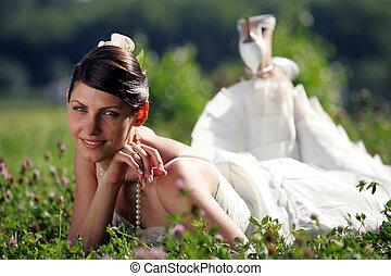 Bride in summer field