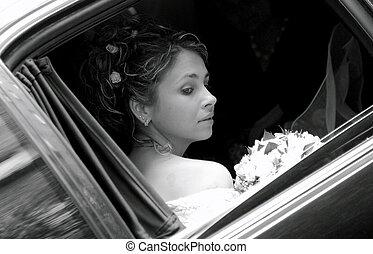 Bride in wedding car limousine