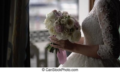 Bride in wedding dress near balcony