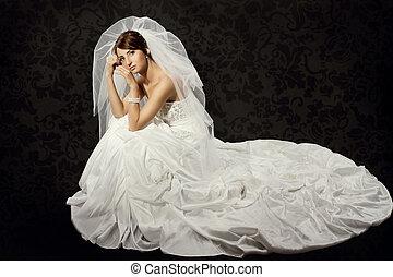 Bride in wedding luxury dress over dark wallpaper background