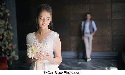 Bride in white dress dress waiting for groom in wedding day indoor