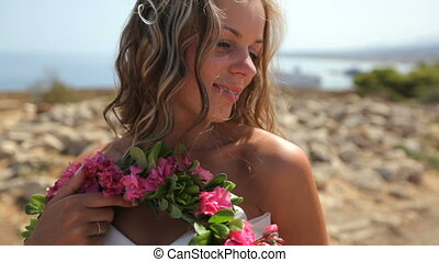 Bride in white dress on the beach. slow motion